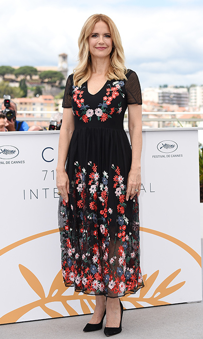 Kelly Preston was fully in bloom supporting husband John Travolta at the <em>Rendezvous With John Travolta - Gotti</em> photocall.
