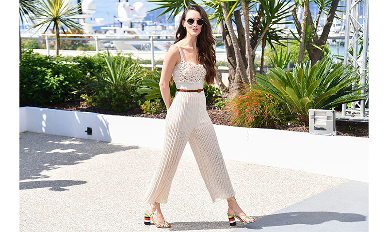 Director Charlotte Le Bon put her best feet forward in a pair of fun, multi-coloured sandals which anchored her sweet knit jumpsuit. 