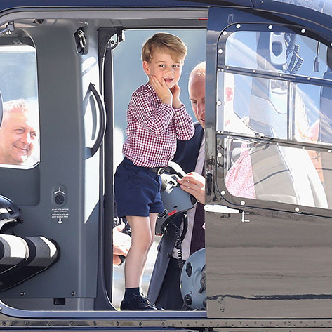 Prince George go to play in a helicopter while on tour in Germany.