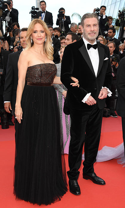 <p>Loved-up Kelly Preston and John Travolta hit the <em>Solo: A Star Wars Story</em> premiere arm-in-arm. The actress wore a simple yet elegant strapless ballgown, while her hubby rocked a velvet tuxedo.</p>