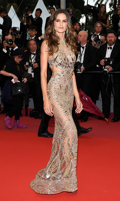 <p>Brazilian model Izabel Goulart hit the <em>Burning</em> red carpet in a sequinned cutout gown.</p>