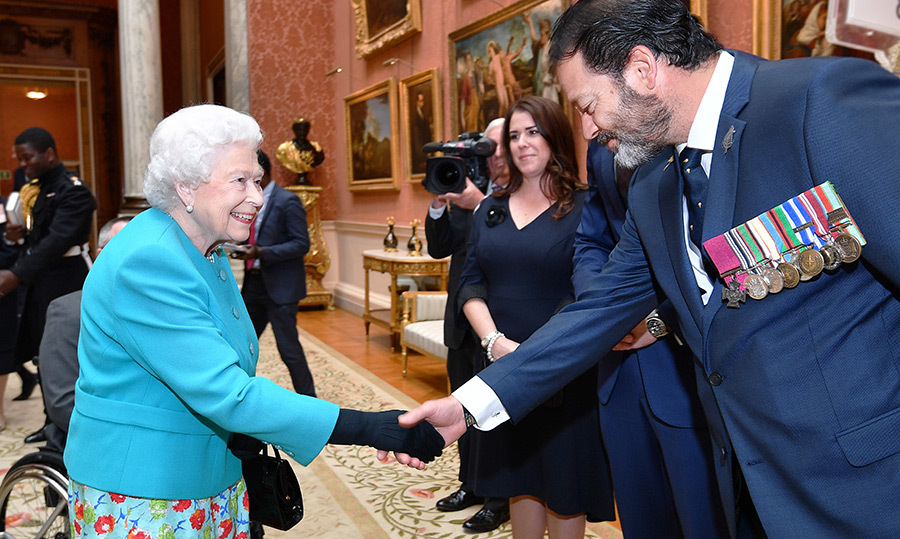 <p>Her Majesty was all smiles while meeting with Willie Apiata VC during a reception at Buckingham Palace on May 16.</p>