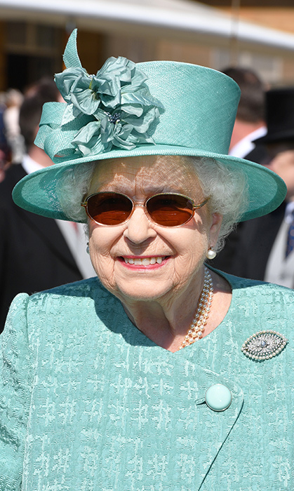 <p>The Queen was all smiles during a garden party at Buckingham Palace on May 15.</p>
