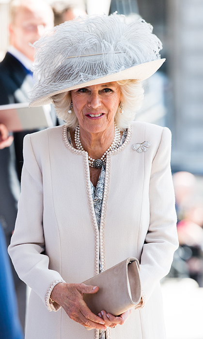 <p>The Duchess of Cornwall stunned in a feathered hat and cream coat while attending a service at Trafalgar Square on May 15.</p>