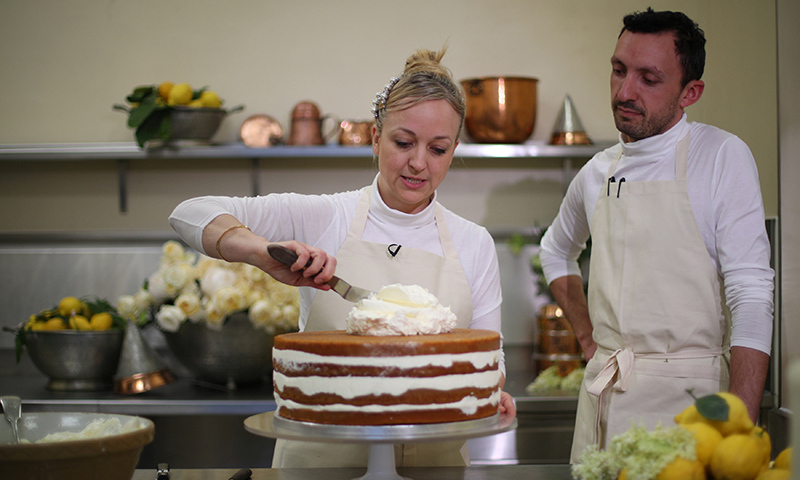 "<h2>Baker Claire Ptak ices the ""ethereal"" royal wedding cake</h2>