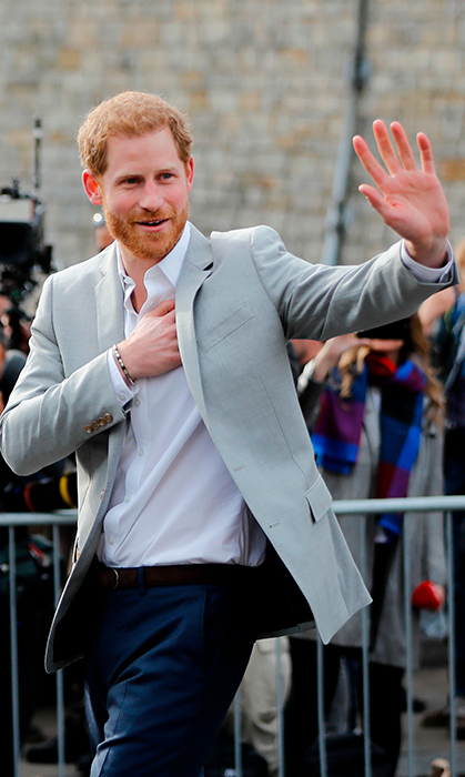 <p>The nearly newlywed waved graciously to his adoring fans and crowds of photographers waiting to catch a glimpse of him. Looking dapper as ever in a grey suit jacket, crisp white shirt and navy pants, the prince showed off his weight loss in preparation for the big day. He's said to have taken a page from Meghan Markle's healthy living book.</p>