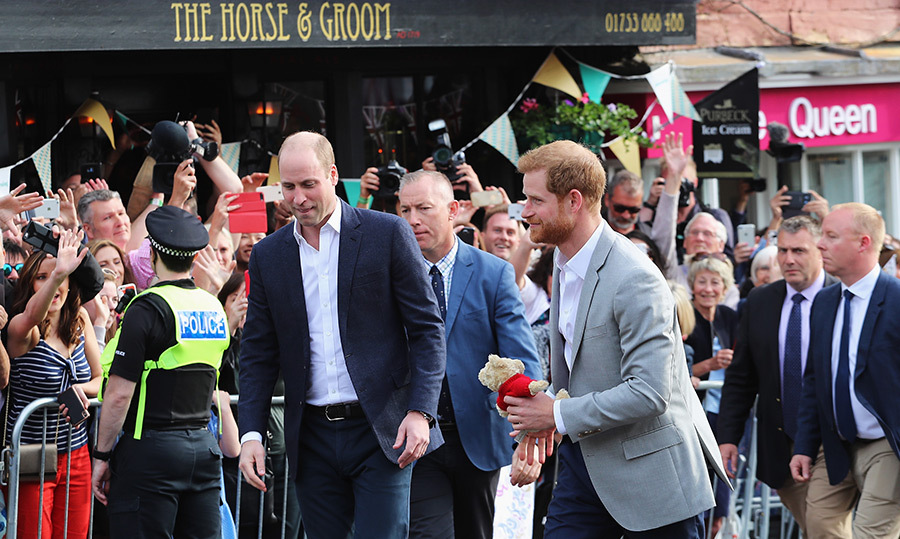 <p>William and Harry walked side by side while passing by Windsor's The Horse & Groom pub. The groom-to-be held onto an adorable teddy bear gifted to him by an well-wisher.</p>