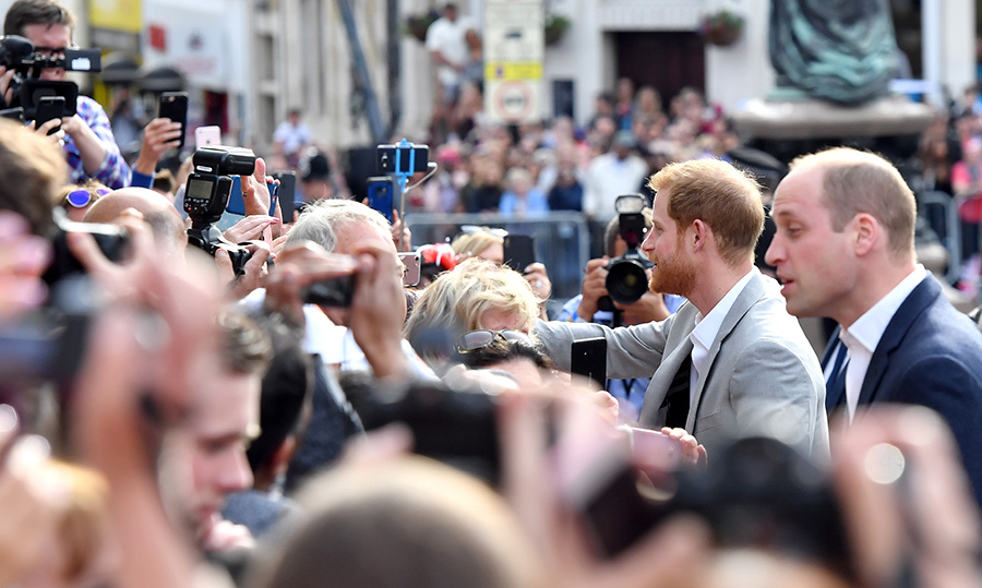 <p>The brothers spent quite a bit of time chatting it up with royal watchers, who waited eagerly outside a Windsor pub.</p>