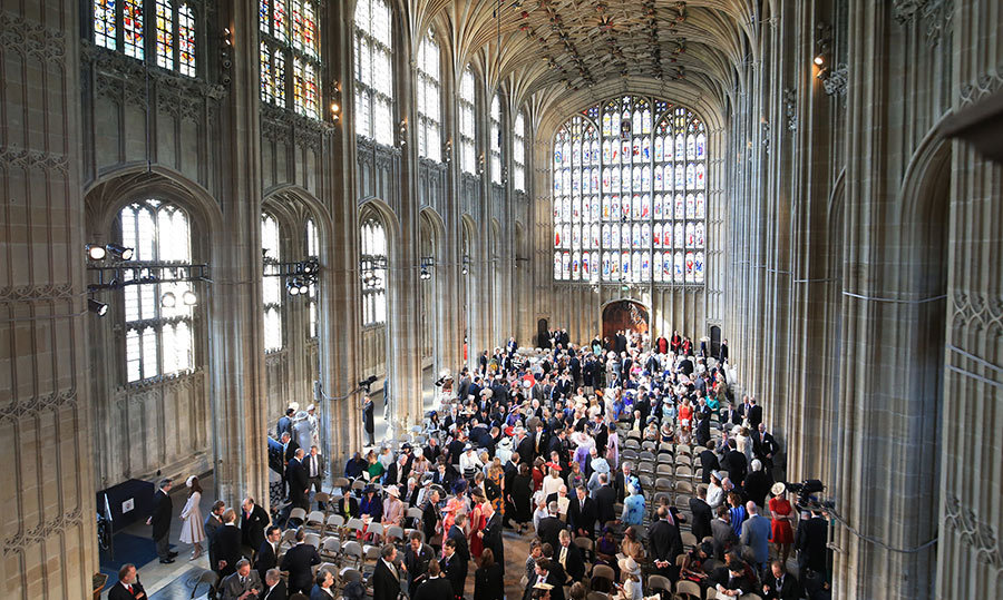 <p>St. George's Chapel quickly filled up with celebrity and royal attendees. The sunny day beautifully shined through the stained glass windows of the chapel.</p>