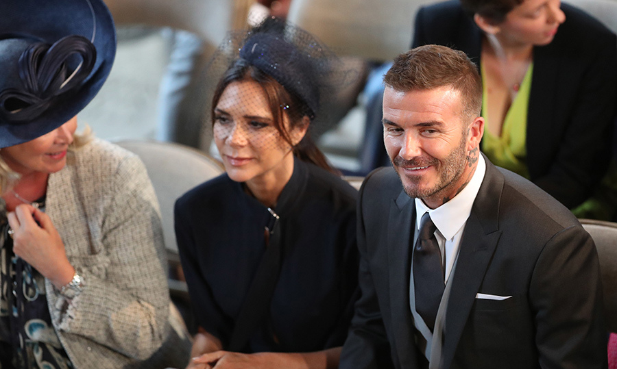 <p>Victoria and David Beckham smiled while sitting in the pews.</p>