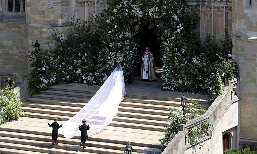 <p>Meghan Markle stunned in a Clare Waight Keller for Givenchy gown. Her veil extended far past her dress's train over the West Steps of St. George's Chapel.</p>