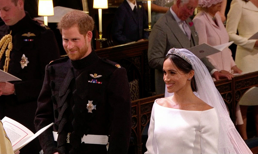 <p>Prince Harry and Meghan Markle cracked a smile at the altar just after arriving in St. George's Chapel.</p>