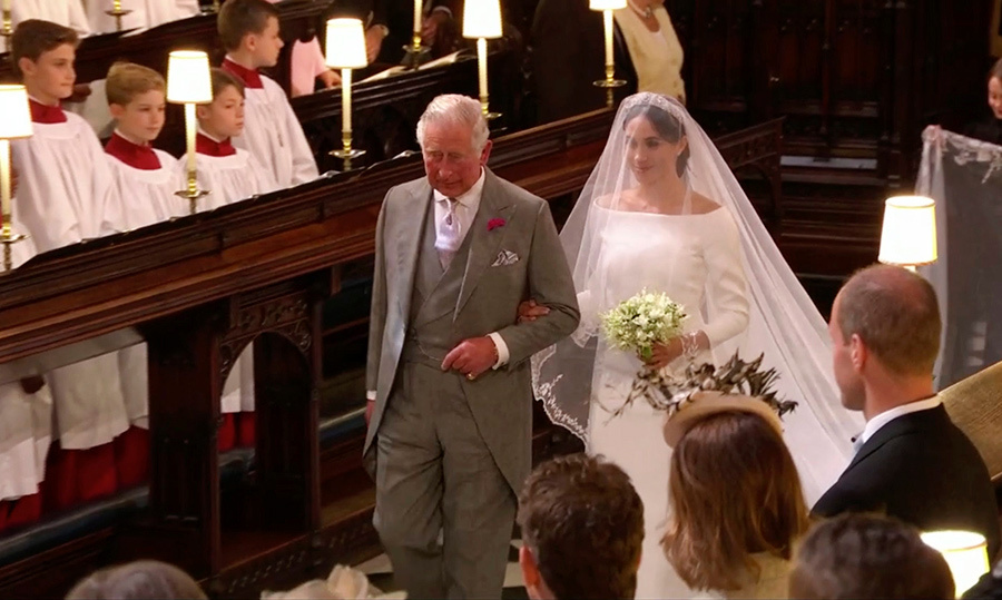 <p>Prince Charles walked his daughter-in-law down the aisle of St. George's Chapel. The stunning bride carried a pretty bouquet of flowers as she approached her husband-to-be, Harry.</p>