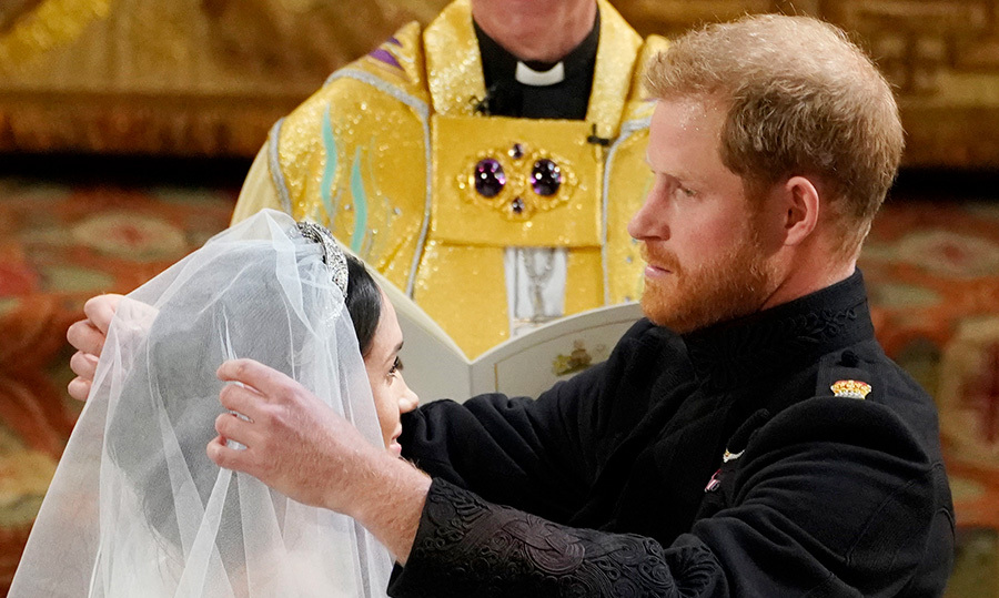<p>Prince Harry lifted back Meghan's veil, revealing his beautiful bride.</p>