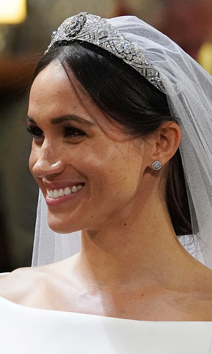 <p>Meghan's natural beauty shined through, as her natural makeup showed off her freckles.</p>