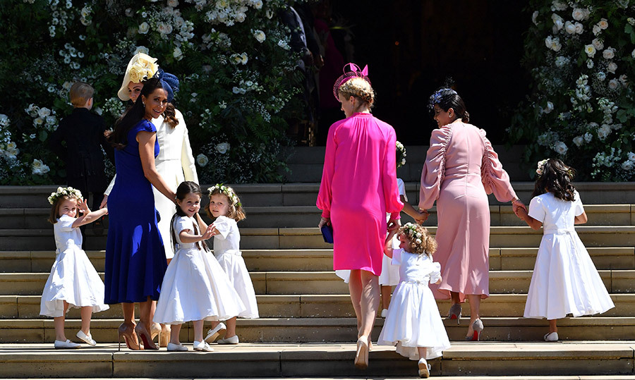 <p>#MomGoals! Duchess Kate and Jessica Mulroney helped organized the adorable bridesmaids on the West Steps of St. George's Chapel.</p>
