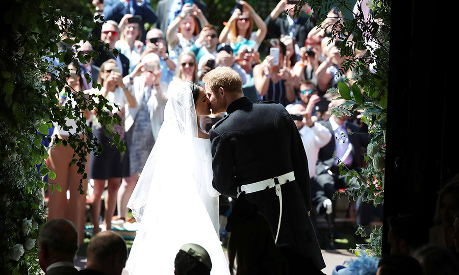 <p>The royal kiss! Meghan and Harry locked lips in front of an excited crowd of well wishers.</p>
