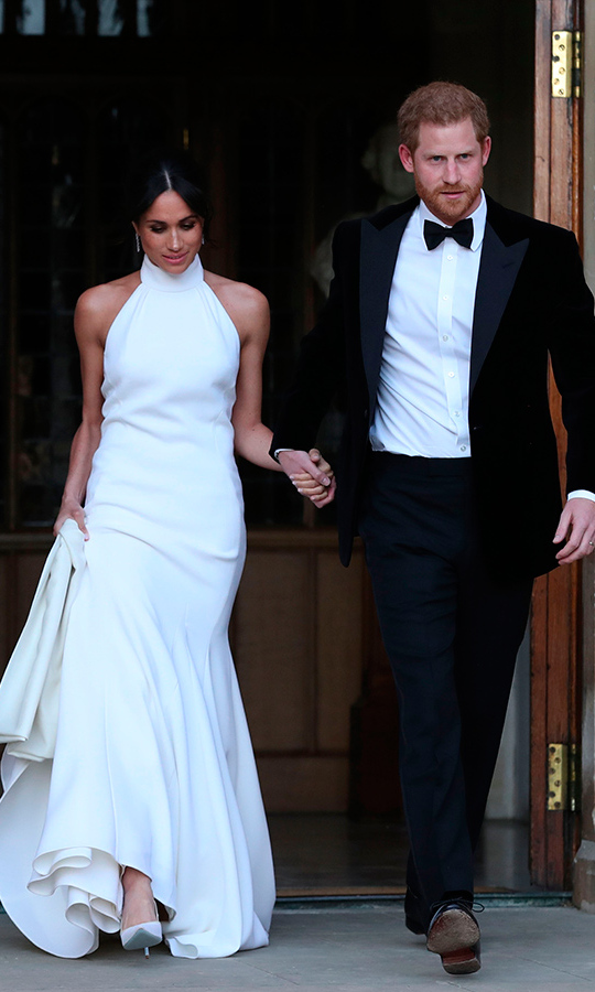 Meghan stunned in Stella McCartney for the couple's intimate second reception, with Harry in a dapper black tux.