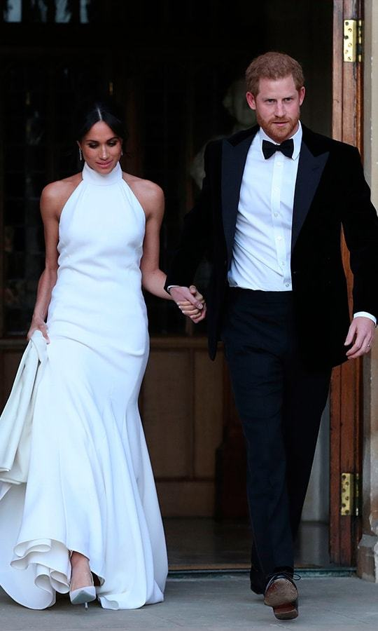 <p>As if Meghan's first wedding gown wasn't beautiful enough, she stepped out for her reception in this gorgeous Stella McCartney number. Crisp white with a halter neck, the new royal was giving us major old Hollywood vibes as she and her husband headed out to celebrate.</p>