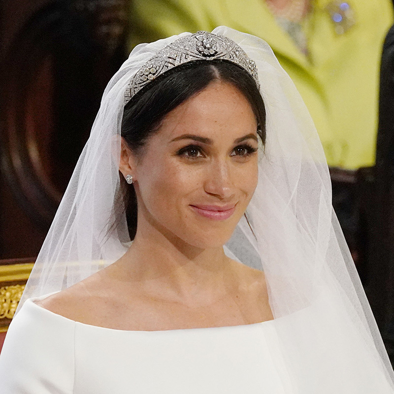 When she married Britain's Prince Harry, the Queen made sure Meghan Markle accessorized her stunning Givenchy wedding gown designed by Clare Waight Keller with the perfect topper - Queen Mary's diamond bandeau. The glittering tiara dates back to 1932 and features interlaced bands of large and small brilliant diamonds with a detachable brooch of ten diamonds at its centre. The latter piece was gifted to Queen Mary by the County of Lincoln to celebrate her marriage to the Duke of York in 1893. Meghan complemented the tiara with a pair of Cartier earrings and bracelet.