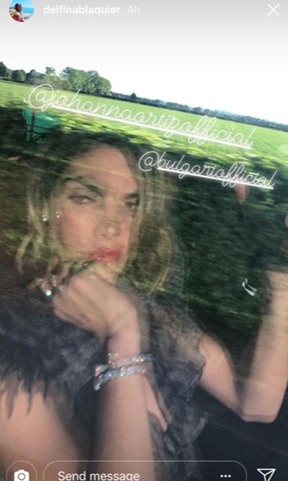 <p>Even in the teasing reflection of her car window, it's plain to see that Nacho Figueras' wife, Delfina Blaquier, glammed it up for the after-party. In her Instagram story, she shared she was in Johanna Ortiz and Bulgari jewels.</p>