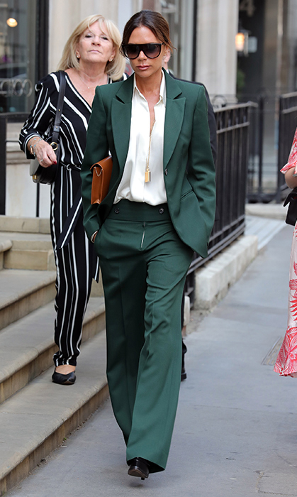 <p>Just a couple days after the royal wedding, Victoria Beckham was spotted leaving her London store on May 22. She stunned in a rich green pant suit.</p>