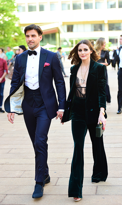 <p>We are in love with Olivia Palermo's green velvet pantsuit! Her and her husband, Johannes Huebl, were spotted walking in Midtown New York City on May 21.</p>
