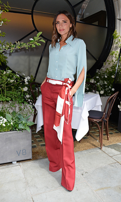 <p>Ever the fashion maven, Victoria Beckham stunned in pale blue and red. She was helping unveil the Scott's Mayfair 2018 summer terrace, which she designed in collaboration with florist Flora Starkey at Scott's Mayfair, on May 21.</p>