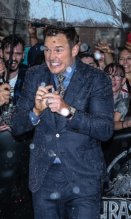 <p>Nobody can rain on Chris Pratt's parade! The star got caught in the rain in Spain while arriving at the <em>Jurassic World: Fallen Kingdom</p> on May 21.</p>