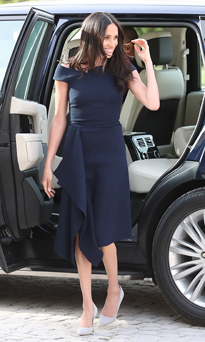 <p>Meghan was positively radiant the day before her royal wedding as she arrived at Clivedon House with her mom, Doria Ragland, to spend her last night as a single woman. The bride-to-be showed off her slim frame in the navy blue Barwick dress by close pal Roland Mouret, which she paired with Manolo Blahnik light grey pumps.</p>