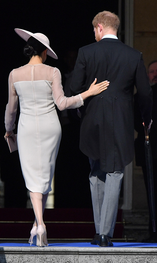 Royal watchers have wondered if the famously affectionate couple will be toning down their public displays as royal husband and wife, but it seems they still managed to get in a tender touch here and there as Meghan placed her hand on her beau's back.