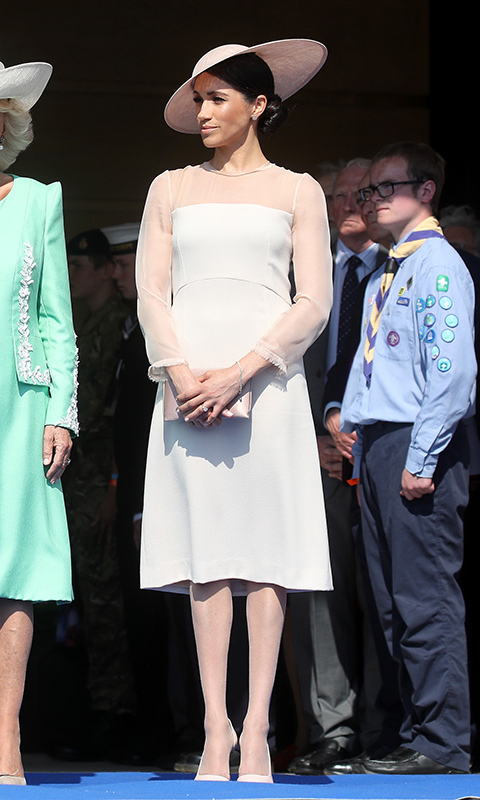 Meghan wore a pretty pastel dress by one of her sister-in-law Kate's go-to labels, GOAT, which she paired with a stunning Philip Treacy hat, Manolo Blahnik pumps and a Wilbur & Gussie clutch. 