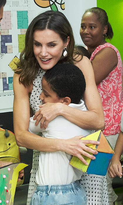 <p>While on a two-day visit to the Dominican Republic, Queen Letizia gave a little boy a big hug while visiting a center for Integral Care for Disability on May 21.</p>