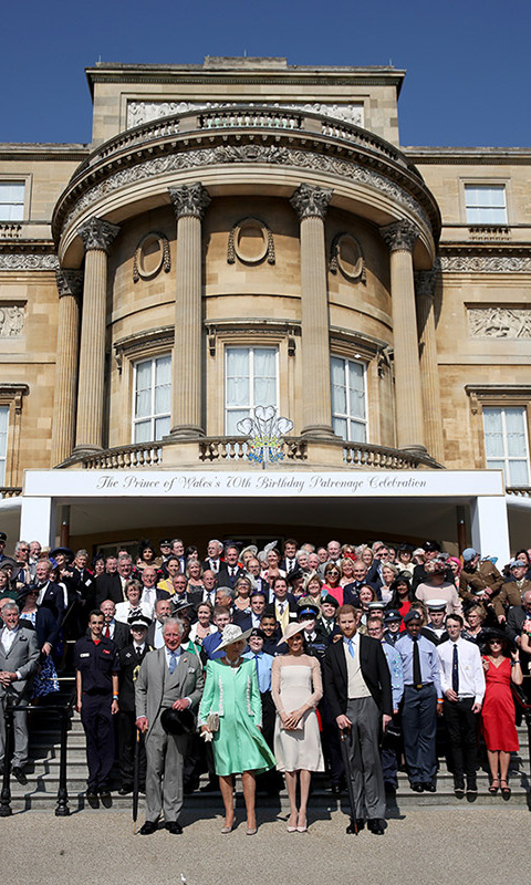 Prince Charles, Camilla, Meghan and Prince Harry posed with attendees from among the 6000 guests all associated with the future king's charities, patronages and military affiliations.