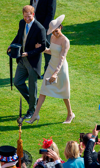 <p>Meghan dazzled in a nude Goat dress and matching hat, as she walked arm-in-arm with her husband, Prince Harry.</p>