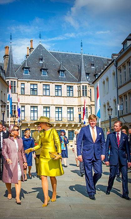 <p>Queen Maxima dazzled in a gold gown alongside her dapper husband, King Willem-Alexander. The royals walked through Luxembourg during their three-day state visit.</p>