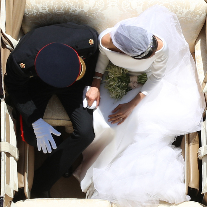 <p>We love all angles of Meghan and Harry's love story, but especially this touching aerial one. The newlywed couple hold hands in their carriage during their Windsor procession.</p>