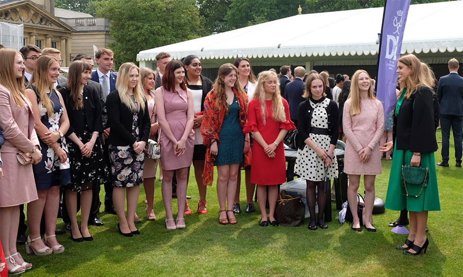 <p>Princess Beatrice met with just some of the students who were award winners on May 24. The royal stunned in a kelly green dress and matching handbag.</p>