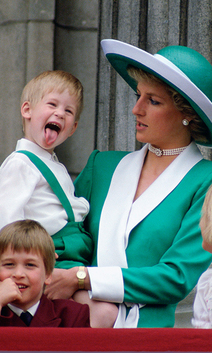 Three-year-old Prince Harry gave his brother a giggle and stunned mom Princess Diana as he entertained the crowds by sticking his tongue out while on the balcony of Buckingham palace during Trooping the Colour. 
