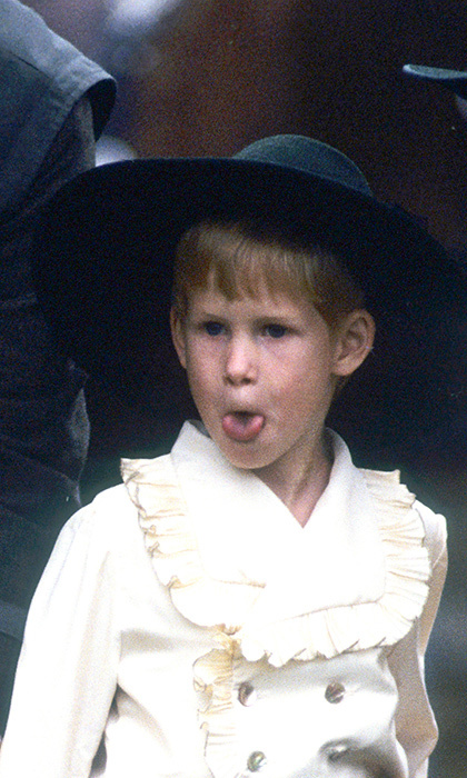 Adorable as ever, Prince Harry grabbed the photographer's attention as a page boy in 1989.