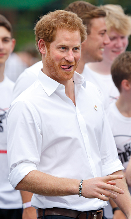 We hope the players weren't looking to Prince Harry's goofy grin to inspire their game faces! The royal brought some silliness to the sidelines as he watched a rugby match in Alexandra Park in 2016.