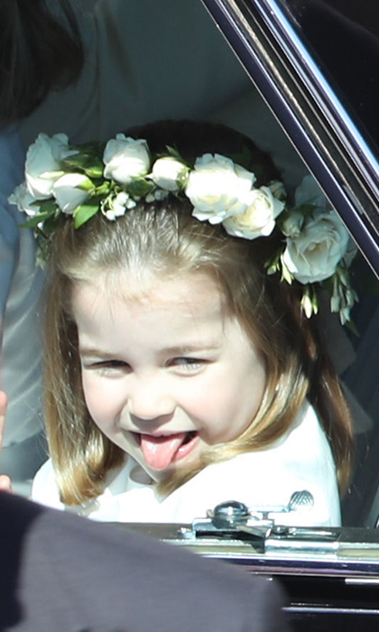 Just like her uncle, Princess Charlotte couldn't hold back a cheeky face as she arrived at St George's Chapel for the wedding of Prince Harry and Duchess Meghan in May 2018. 
