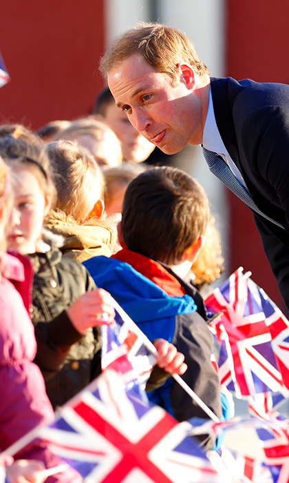 Prince William brought out his inner child as he entertained local school children at the Haven Point Leisure Centre 