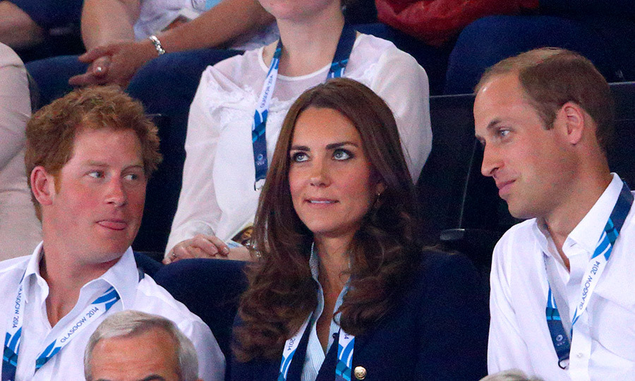 Playful Prince Harry tried to get his brother Prince William and sister-in-law Kate's attention while the trio took in a gymnastics event at the 2014 Commonwealth Games in Glasgow. The couple was clearly fighting back laughs...
