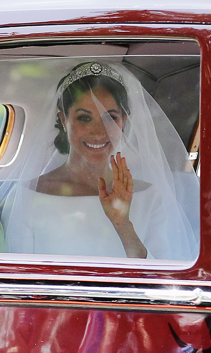 Snapped by photographer Richard Heathcote, this cinematic image was our first glimpse of Meghan Markle as a royal bride, as she rode in a vintage car with her mother Doria Ragland to the wedding at St George's Chapel. While we couldn't see the Givenchy wedding dress yet, we were able to spot Meghan's wedding jewellery of choice – Queen Mary's tiara. 