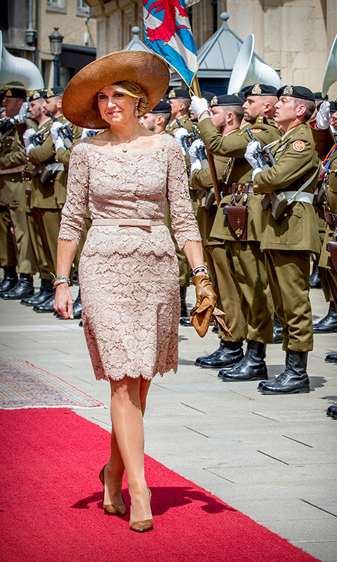 Queen Maxima also pulled out an old favourite, this brown woven hat with a large asymmetrical brim, while in Luxembourg. She paired the pretty topper with matching suede shoes and a pale pink lace dress. 