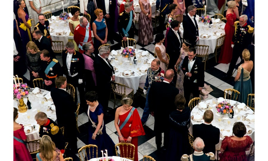 Attendees like Crown Princess Victoria and Prince Daniel were shown to formal tables, standing until the evening's guests of honour were seated.