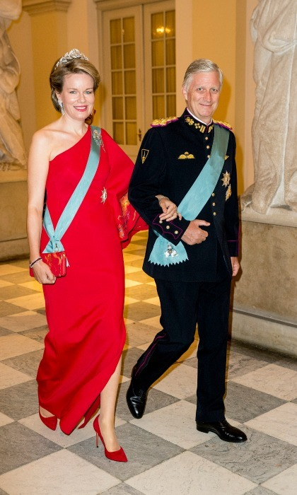 Belgium's King Philippe and Queen Mathilde were on hand for the festivities, where she looked spectacular in a red one-shoulder gown with matching lips and accessories and, of course, a dazzling tiara.