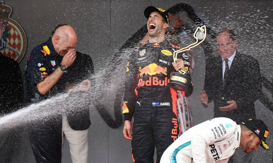 Splash zone! Daniel Ricciardo and Mercedes' British driver Lewis Hamilton were also sprayed with champagne during the podium celebration. Charlene and Albert got caught in the line of fire as they were sprinkled in the back.