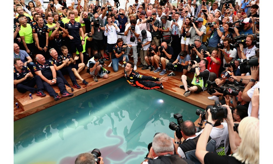 Belly flop! Still reeling from his incredible win, Daniel and his Red Bull racing team celebrated with a swan dive into the Red Bull energy station swimming pool.